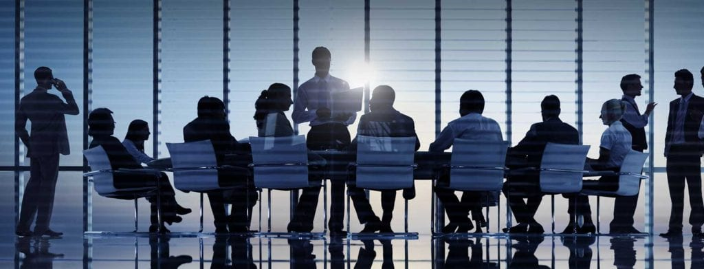 sales executives at a conference table for sales training